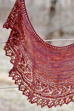 Free Knitting Pattern for Regina Marie One Skein Shawlette -  This crescent shawlette features a border of cables, dayflower lace, and a leafy edging using a method of keeping live stitches on the needle that eliminates the need to pick up stitches. Uses just 300 yards of lace weight yarn. Perfect for a small skein of multi-color yarn. Designed by Sara Huntington Burch