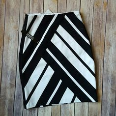 """HOST PIC NWT Black & White Pencil Skirt SOLD OUT! Bold blocks of black and white ponte transform a classic pencil silhouette into a modern statement. Artfully constructed with pieced panels and appliquéd  stripes, Designed with hidden shapewear, it smooths, controls and stabilizes for a confident look.  Hidden 4 inch top side zipper Mid-weight stretch pont knit over shapewear lining Shell: 62% rayon, 33% nylon, 5% spandex 21"""" length White House Black Market Skirts Pencil"""