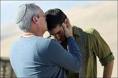 Powerful photo of a father blessing his son as he is called upon to defend Israel. www.facetozion.com