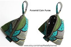 African Print zipper pyramid pouch. Green flowers and other fabric  are available sur Etsy