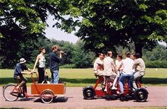 The 7-seat conference bike being filmed from a cargo bike