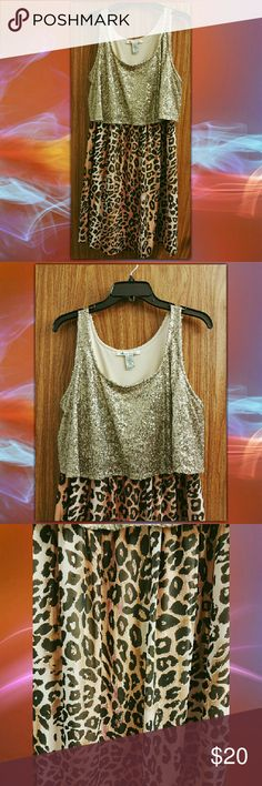 Vintage American Rag Holiday Dress There's no denying that you will be the talk of the party in this super unique leopard print-glitter top dress from American Rag. The tank top is covered in high quality gold sequins while the attached skirt contains two layers of chiffon. A truly unique find. Tag says XL, but can also be defined at the waistline with a belt to make this dress wearable by anyone. Hand picked find. American Rag Dresses