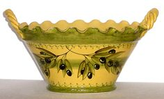 """This delightful French ceramic tagine is oven-safe, made in southern France and painted with dark olives on a golden background with sage green details.    Hand made in Vallauris, France perched high above the French Riviera--a region with a rich tradition in French pottery production.     Size: 11"""" diameter, 10"""" tall"""