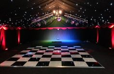 chequered dance floor with blackout starlight linings & stage by www.24carrotevents.co.uk
