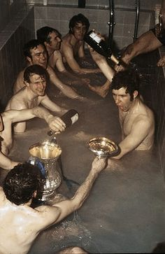 Bath time: Chelsea's players celebrate with champagne in the bath