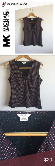 "Michael Kors Tank Top Excellent condition Michael Kors Tank top. Black with red and white diamond/dots. V-neck cut. Size large. Material is 100% polyester. Pit to pit measures 17"" and from shoulder to bottom measures 22"". Michael Kors Tops Tank Tops"