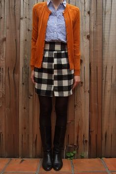 """I love this look specifically because the plaid doesn't line up and one is never to mix orange and blue. True to the """"contrary"""" part of this Mary."""