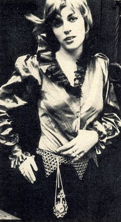 Gabrielle Crawford in an Elizabethan pageboy blue and green striped silk shirt from the new Miss Fish collection, 15 gns to order. She's just back from Rome where her husband Michael has been starring in The Games. Miss Fish is the latest addition to the Mr Fish family, 17 Clifford St, W.1.  Scanned from Vogue, June 1969. Photo by Patrick Lichfield.