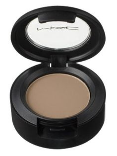 MAC Eye Shadow in Omega. Great crease and lid shade, and perfect brow powder for blondes. I like layering this under shimmer shades for more depth. Also a natural cheek contour powder for fair skins.
