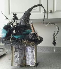 Halloween vintage style witches hat on a spell book stand made for a charity Hat contest 2015 Halloween Witch Hat, Halloween Porch, Holidays Halloween, Vintage Halloween, Halloween Fun, Witch Hats, Halloween Decorations, Vintage Witch, Autumn Crafts