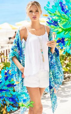 Please welcome your newest favorite beach cover up: The Island Caftan - Wade And Sea. The printed kimono scarf looks great over your bathing suit, has tassels and a self-tie closure. What more could you ask for?