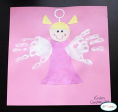 Handprint Angel - Pre-cut angel parts (face, dress & hair) to construction paper. Adding the wihite handprints makes her fly.  | Meet the Dubiens