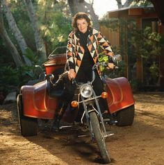 American film star Jane Russell riding a trike motorcycle, 1985.