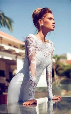 Delicate long-sleeved wedding dress  Check out the website for more