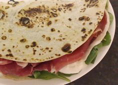 All over Emilia-Romagna you can find the region's famous snack Piadina served with local cheese or cured meat...