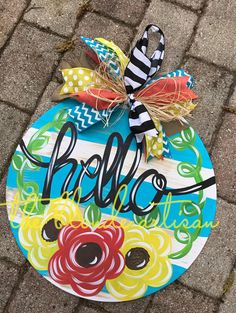 Hello Floral door hanger that is Perfect for Spring & Summer to bring that perfect pop to any entrance! Ribbons may vary due to availability. Personalize it any way you want it.