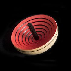 We've got you spinning! This maple wood spinning top rocks the planet. Pick between yellow or red and make the world turn upside down, seeing how quickly you can make it go. Handmade in Germany Material: maple wood Diameter: Spinning Top, Put Together, Ufo, Germany, Handmade, Top, Hand Made, Deutsch, Handarbeit