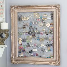 Like any collector of tiny objects, Marty, of the blog Marty's Musings, needed a neat way to wrangle groups of tiny objects. To display her jewelry, she turned a $1 yard-sale frame into an earrings organizer. She completed the project with gold paint, chicken wire, wood backers, and picture wire. See how she did it here.