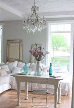 White Farmhouse French Style, aqua blue bottles, chandelier, rustic mirror