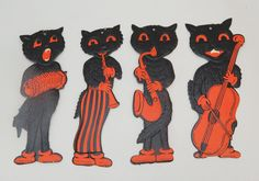Four black cat decorations (flat) with orange details. One is playing accordion. Because cats know how to do that? Vintage Halloween Decorations, Holiday Decorations, Halloween Gif, Cat Decor, Vintage Holiday, National Museum, Hallows Eve, Vintage Advertisements, Cat Art