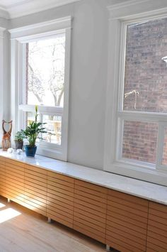 mansion  window radiator cabinet | wooden radiator cover that serves as a window sill and a display shelf