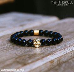 Black onyx and 18kt gold bracelet charm by North Skull