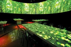 B[eye]t creates moving, interactive lighting projections on tabletops and walls.
