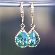 New Color/ Sea Glass Crystal Teardrops Framed in Gold, Hanging From French Jeweled Earrings. $38.00, via Etsy.