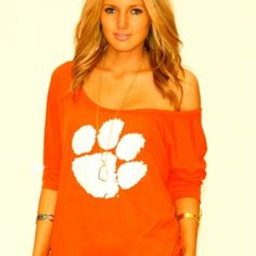 Clemson Off-the-Shoulder ¾ Sleeve. Ridiculously sexy school spirit. Super stretchy, lightweight fabric features gorgeous drape.