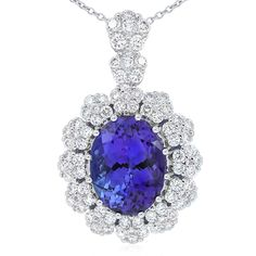 Rare and beautiful. Kilimanjaro tanzanite and diamond floral cluster style pendant. This oval tanzanite is a deep purple-blue colour and weighs 4.85carats. Crafted in 18ct white gold. The 18ct gold chain is adjustable from 42 - 45cm long.