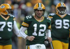 Aaron Rodgers #12 of the Green Bay Packers participates in warm-ups before a game against the Oakland Raiders at Lambeau Field on December 11, 2011 in Green Bay, Wisconsin.