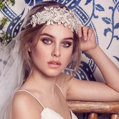 A lovely statement that can be worn as a headband or a sash. Intricately beaded with dazzling crystals and shiny glass beads. Shown worn over a plain cap veil.