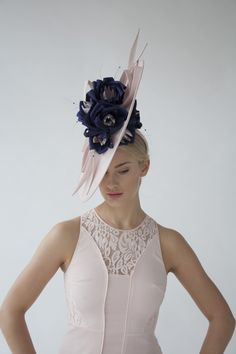 Handcrafted in our London studio.Sinamay hat with handmade silk flowers, sinamay twists and swarvoski beads. Colours: Nude, Purple, Pink. Secured with a hairband.Sent free within the UK. Includes a Black