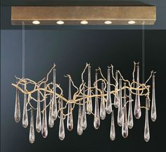 Beautiful glass teardrops suspended from a golden twig. Very organic |  Aqua by Serip Organic Lighting ICFF13