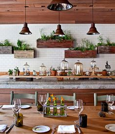 Charming Talula's Garden restaurant in Philadelphia.  #restaurant #design #garden..what would those boxes look like on the brick wall in the kitchen. ....full of fragrant herbs?????