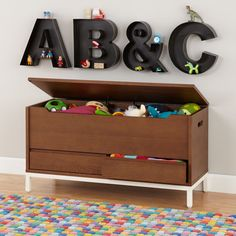 Shop Hi-Fi Sleek Modern Toy Box (Walnut).  The streamlined design of our Hi-Fi Toy Box will fine-tune any décor.  Its spacious interior and additional drawers give it plenty of storage space, while its powder coated iron base makes it ultra durable.