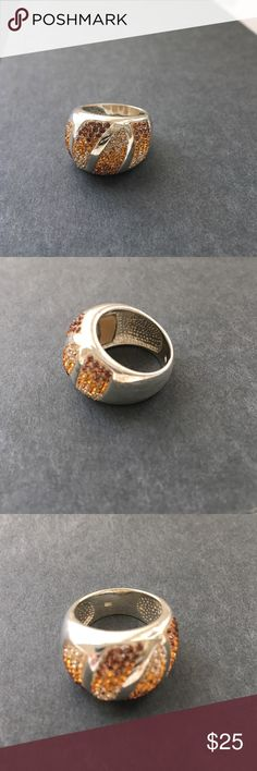 Orange Ombre Sparking rhinestone ring Orange ombre rhinestone ring. Sparkling and shiny. A great ring. Fades from diamond to brown/orange. Stunning piece. 925 sterling silver. Not sure of size but probably 7 or 8. Vintage piece so does have signs of wear, scratches and discoloration. Jewelry Rings