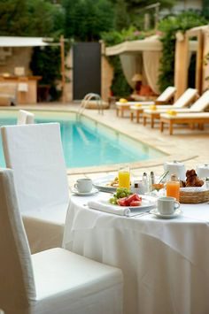 Breakfast by the pool - The Margi Hotel in Athens, Greece.  ASPEN CREEK TRAVEL - karen@aspencreektravel.com