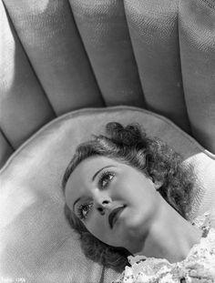 Bette Davis Lying on the Couch in White Dress Premium Art Print