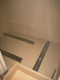 Drawer slides for corner cabinet, hidden slides would need to be positioned high enough to pass over the 1st pull out.