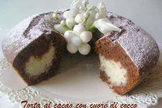 TORTA AL CACAO CON CUORE DI COCCO. La ricetta qui: http://www.petitchef.it/ricette/dessert/torta-al-cacao-con-cuore-di-cocco-fid-331783