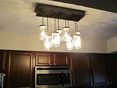 Mason Jar chandelier for my kitchen replacing that ugly flourescent fixture