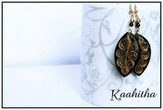 Quilled earrings... Please visit https://kaahitha.facebook.com for new designs :-)