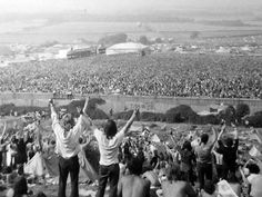 The sea of humanity that was the 1970 Isle of Wight festival. This picture was taken not far from where we spent the first couple of days sitting on the hillside overlooking the enclosure. The stage was a long way away (top left), but on that hillside we still saw it and felt it. Malcolm George's photo, on www.ukrockfestivals.com.