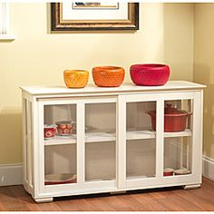 @Overstock.com - Sliding Door Stackable Cabinet - Solve all your storage needs with this unique stackable cabinet in an antique white finish compatible with any existing decor. This sleek cabinet has acrylic sliding doors and is easy to stack for an endless supply of storage options.  http://www.overstock.com/Home-Garden/Sliding-Door-Stackable-Cabinet/6420584/product.html?CID=214117 $121.49
