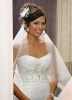 wedding-hairstyle-sideswept-updo-with-tendrils-white-fabric-flower-in-hair