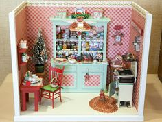 """""""Christmas Kitchen"""" in scale by Barbara Adams, San Jose, CA, member of Through the Looking Glass Miniature Club. """"I repurposed the hutc. Christmas Room, Christmas Kitchen, Christmas Holidays, Christmas Minis, Christmas 2019, Christmas Crafts, Mini Kitchen, Miniature Kitchen, Miniature Houses"""