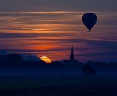 Hot Air Ballon during Sunset by Teus Renes, via 500px