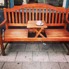 What a cute idea! Little bench with coffee table.  Couples and friends will enjoy!