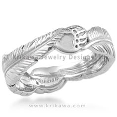 Feather & Bear Claw Wedding Band - This organic wedding ring has two eagle feathers and two bear claws, spiritual Native American symbols.